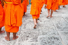 Group of young Buddhist novice monks walking. Close up of a group of young Buddhist novice monks walking Royalty Free Stock Image