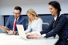 Group of business partners discussing ideas and planning work in office. Group of young business partners discussing ideas and planning work in office Royalty Free Stock Photo