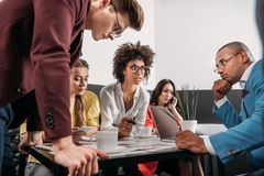 group of young business partners having conversation royalty free stock photo