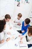 Group of young business partners in a meeting Royalty Free Stock Photo