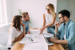 Group of young business people and architects working on project Stock Image