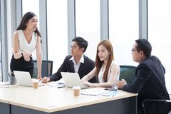Group of young business people brainstorming together in the meeting room . Businesswoman presenting to colleagues .teamwork stock images