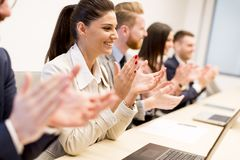 Young business people clapping their hands in office Royalty Free Stock Images