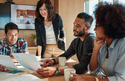 Team brainstorming in meeting room with color palette. Group of young business people and designer looking at color palette. Team brainstorming in meeting room stock photos