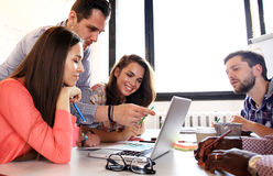Group of young business people and designers.They working on new project. Stock Photography