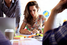 Group of young business people and designers.They working on new project. Royalty Free Stock Photo