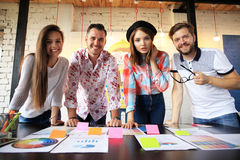 Group of young business people and designers. They working on new project. Startup concept royalty free stock photos