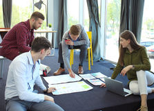 Group of young business people and designers. They working on new project. Startup concept. Stock Images