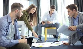 Group of young business people and designers. They working on new project. Startup concept. Royalty Free Stock Images