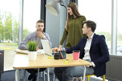 Group of young business people and designers. They working on new project. Startup concept. Stock Image