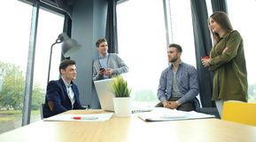Group of young business people and designers. They working on new project. Startup concept. Royalty Free Stock Photography