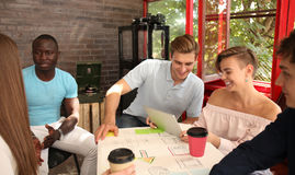 Group of young business people and designers.They working on new project.Startup concept. Stock Image