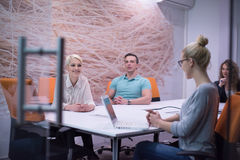Startup Business Team At A Meeting at modern night office buildi Stock Photo