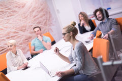 Startup Business Team At A Meeting at modern night office buildi Stock Photography