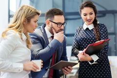Group of business people discussing the latest details about the project in the office Royalty Free Stock Photo