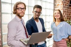 Group of young business people standing in the loft office stock photo