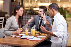Group of young Business people enjoy in lunch at restaurant Royalty Free Stock Photography