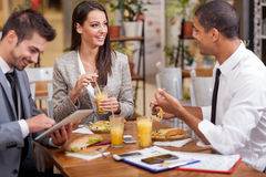 Group of young Business people enjoy in lunch at restaurant Royalty Free Stock Photo