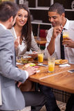 Group of young Business people enjoy in lunch at restaurant Stock Photos