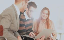 Group of young business people gathered together discussing crea Royalty Free Stock Images