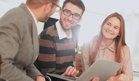 Group of young business people gathered together discussing crea Stock Image
