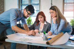Group of young business people in smart casual wear working together stock images