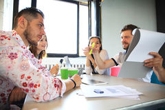 Group of young business people , Startup entrepreneurs working on their venture in coworking space. stock image