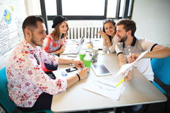 Group of young business people , Startup entrepreneurs working on their venture in coworking space. stock images