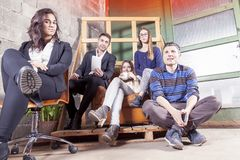 Group of young business people takes a moment to relax. During new start up activity Royalty Free Stock Images