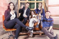 Group of young business people takes a moment to relax Royalty Free Stock Image
