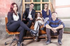 Group of young business people takes a moment to relax. Start up a new office activity concept Stock Photo