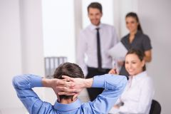 Group of young business people talking on business meeting. royalty free stock images