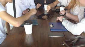 Group of young business people using tablet in coffee shop. Group of young business people using tablet in coffee shop stock video footage