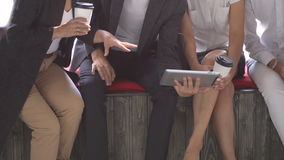 Group of Young Business People using Tablet in Coffee Shop. Slow motion. Group of Young Business People using Tablet in Coffee Shop stock footage
