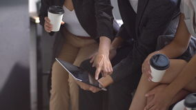 Group of young business people using tablet in coffee shop. slow motion. Group of young business people using tablet in coffee shop stock video footage