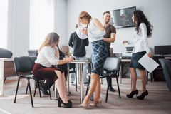 Group of young business people working and communicating together in creative office royalty free stock images
