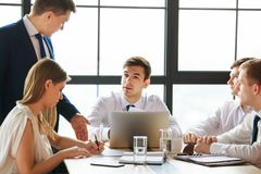Group of young business people working in office. stock photos
