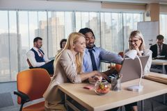 Young business people working together in creative office. Selective focus. Group of young business people working together in creative office. Selective focus royalty free stock images