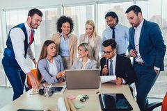 Young business people working together in creative office. Selective focus. Group of young business people working together in creative office. Selective focus royalty free stock photography