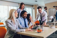Young business people working together in creative office. Selective focus stock photo