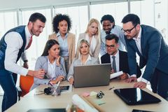 Young business people working together in creative office. Selective focus royalty free stock photo