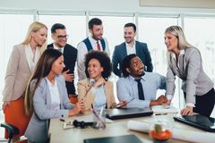 Young business people working together in creative office. Selective focus royalty free stock photos
