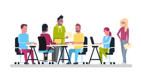 Group Of Young Business People Working Together Sit At Office Desk Coworking Mix Race Creative Workers Team. Brainstorming Meeting Flat Vector Illustration Stock Photos