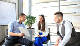 Group of young business professionals. Having a meeting. Diverse group of young designers smiling during a meeting at the office stock images