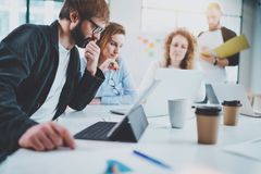 Group of young business team making conversation at sunny meeting room.Horizontal.Blurred background. Royalty Free Stock Photography