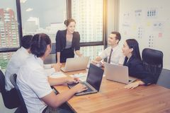 Group of young business team with woman manager standing leader meeting in conference room. Group of young business team with women manager standing leader Stock Images