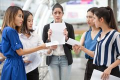 Happy young businesswoman is showing money and laptop with blank copy space screen and clipping path in urban city. girl holding. Group of young business women stock photography