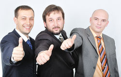 Group of young businessmen together on light backg Royalty Free Stock Photography