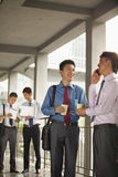 Group of young businessmen working and discussing outdoor Royalty Free Stock Images