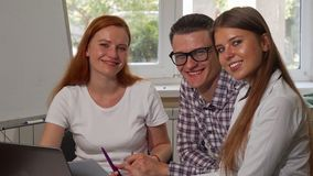 Group of young businesspeople smiling to the camera while working together royalty free stock photography